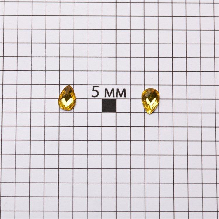 Стразы клеевые пластиковые. Желтый. Длина 9 мм, ширина 6мм.