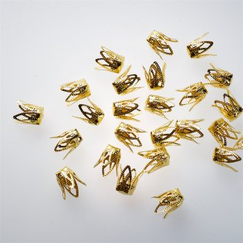 Конуси і ковпачки золоті