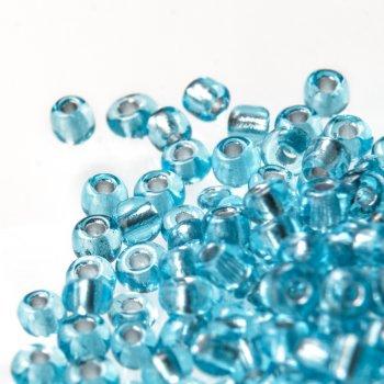 Бісер круглий, дрібний, блакитний із срібною серединою. Калібр 12 (1,8 мм)