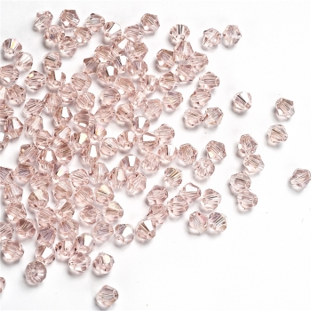 Хрустальная бусина биконус 6 мм розовая прозрачная