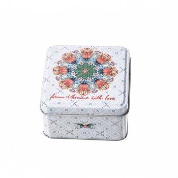 Жерстяна коробочка з квітковим малюнком