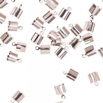 Затискачі для шнурів. Мельхиоровый. Довжина 10 мм, діаметр 6 мм
